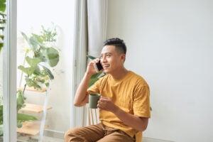 man on phone drinking tea
