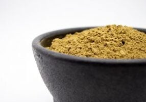 kratom extract in black bowl
